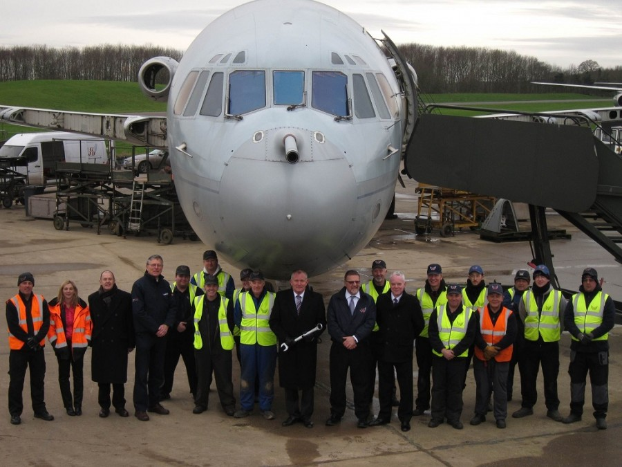 Sir Kevin Leeson, centre, plus Trustee Martin Hine, members of the RAF Museum Project Team, Gary Spoors and the GJD Team in front of XR808.