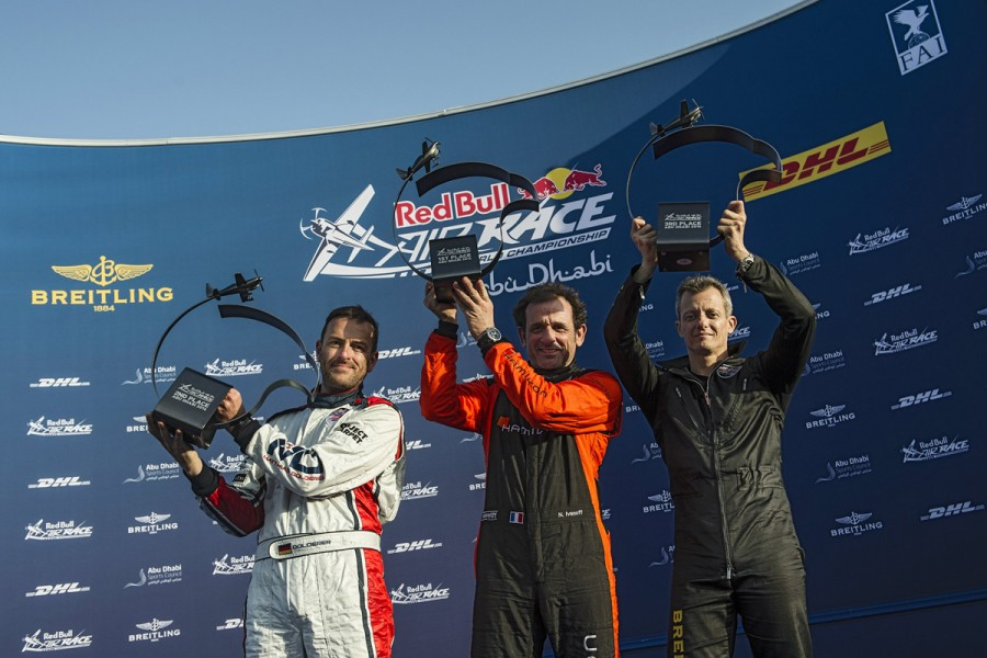 Nicolas Ivanoff of France (C), Matthias Dolderer of Germany (L), Francois Le Vot of France (R) celebrate during the Award Ceremony of the first stage of the Red Bull Air Race World Championship in Abu Dhabi, United Arab Emirates on March 12, 2016. // Joerg Mitter / Red Bull Content Pool